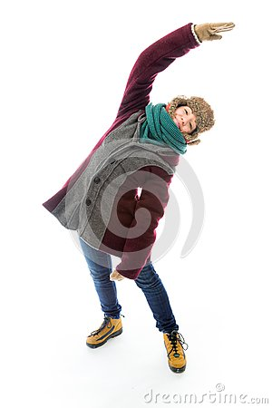 Young woman in warm clothing and stretching