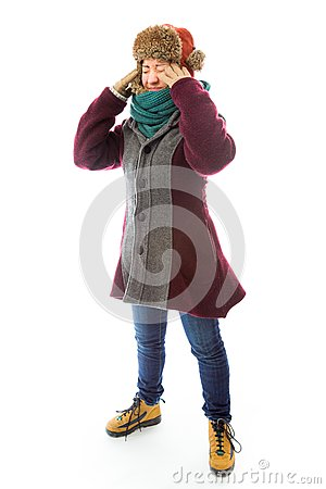 Young woman in warm clothing suffering from headache