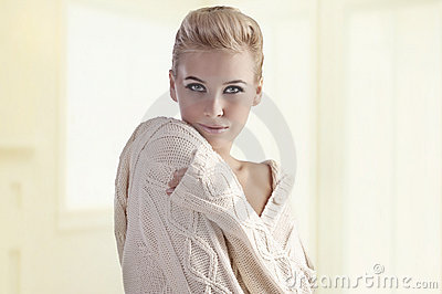 Young woman in a warm woolen sweater