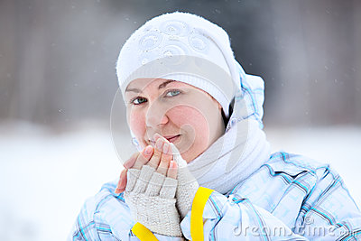 Young woman warming fingers