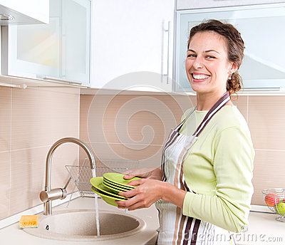 Young Woman Washing Dishes