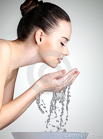 Free Young Woman Washing Her Face With Clean Water Royalty Free Stock Photos - 21172578