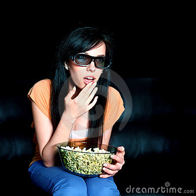 Young woman watching 3D TV