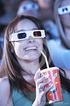 Young Woman Watching A 3D Movie In Theatre