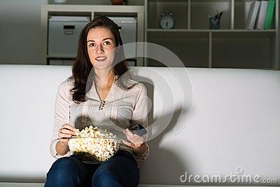 Young woman watching TV
