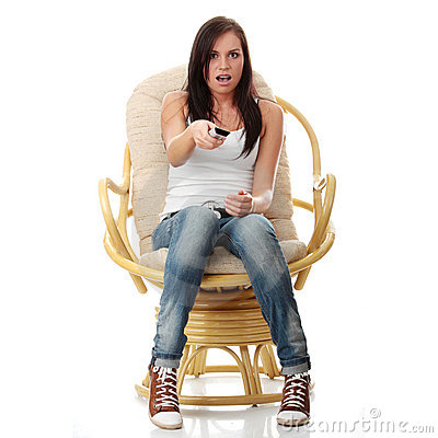 Young woman watching TV - scared
