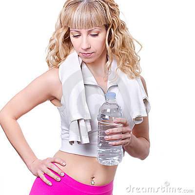 Young woman with a water bottle after workout