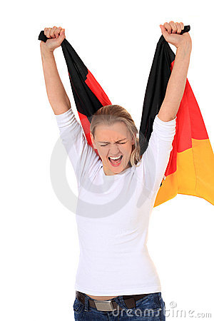 Young woman waving german flag
