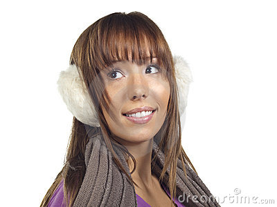 Young woman wearing ear muffs and scarf