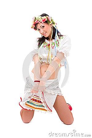 Young woman wearing a folk ukrainian dress posing