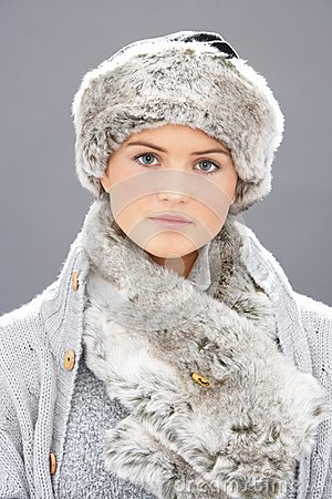 Young Woman Wearing Fur Hat And Wrap