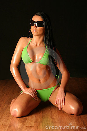 Young woman wearing green bikini