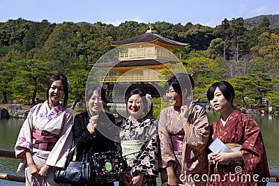 Young woman wearing kimono,Golden Pavilion Temple Editorial Photo