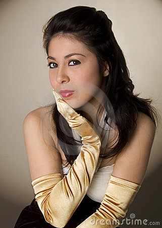 young woman wearing long gold gloves stock photography
