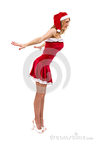 Young woman wearing santa claus clothes posing