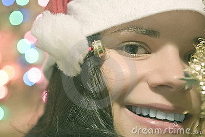 Young woman wearing Santa hat happy for Christmas