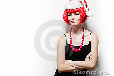 Young woman wearing Santas hat.