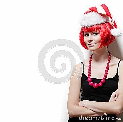 Young woman wearing Santas hat.