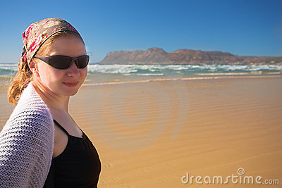 Young woman wearing sunglasses on the beach at Muizenberg