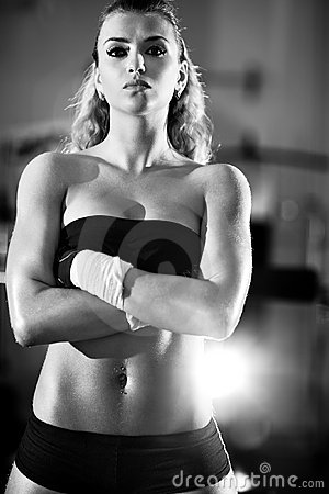 Young woman after weight training