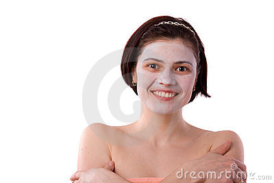 Young woman with a white clay facial mask.