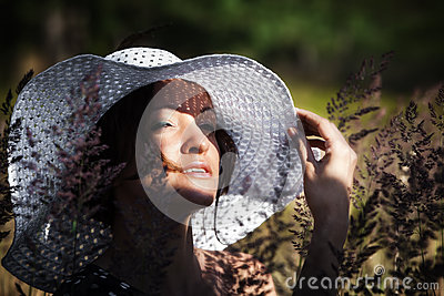 Young woman in white hat