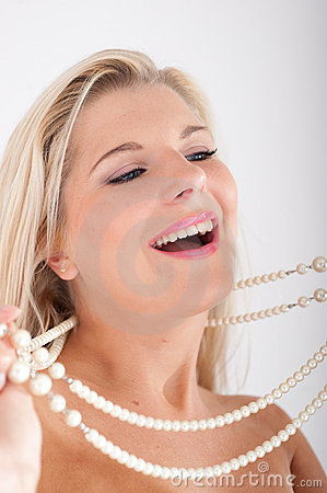 Young woman with white healthy teeth and pearls