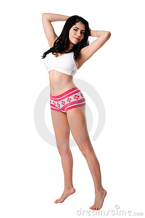 Young woman in white underwear stretching tiptoe