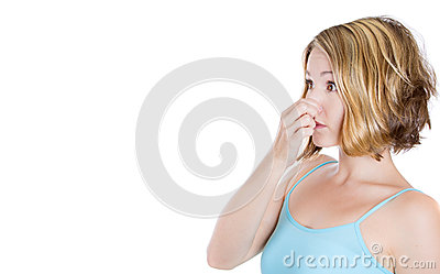 young woman who covers her nose, looks at a copy space , something stinks, very bad smell, situation