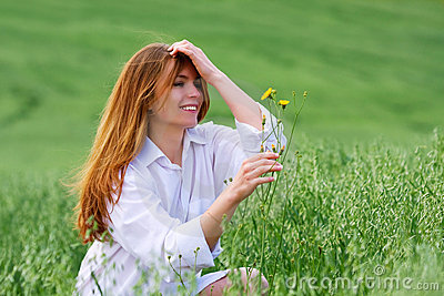 Young woman and wild flowers.