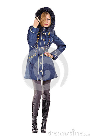 Young woman in winter blue hooded jacket