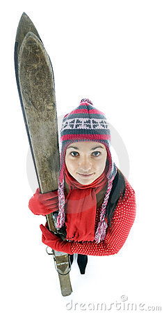 young woman in winter cap holding old ski