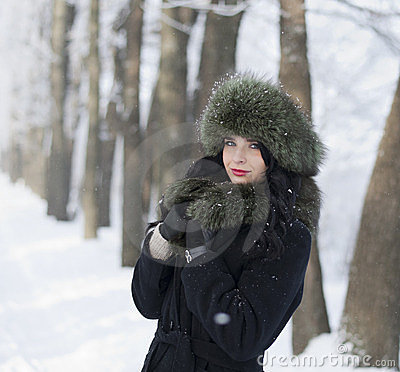 Young woman in winter clothes in the park
