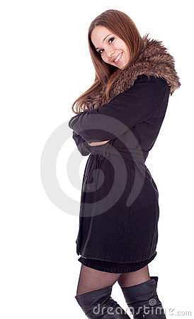 Young woman in winter jacket with fur