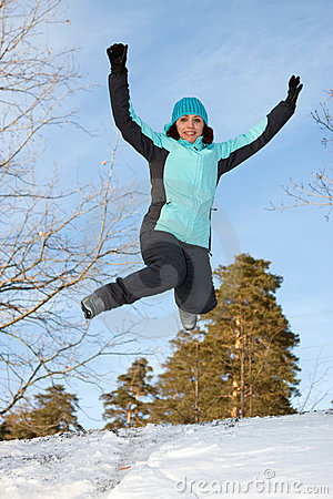 A young woman in the winter jump