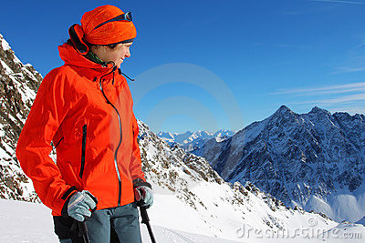 Young woman in winter mountains