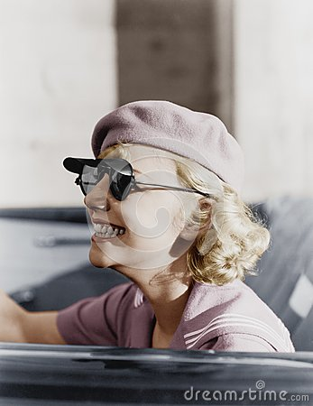 Free Young Woman With A Beret And Sunglasses In A Car, On The Go Royalty Free Stock Images - 52023649