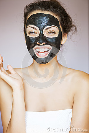 Free Young Woman With A Mask For The Face Of The Therapeutic Black Mu Royalty Free Stock Image - 61260916
