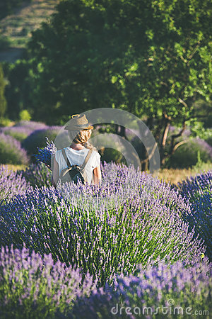 Free Young Woman With Backpack Standing In Lavender Field, Isparta, Turkey Stock Photo - 96355480