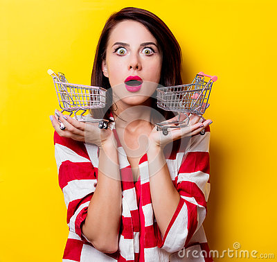 Free Young Woman With Carts Royalty Free Stock Photo - 74456385