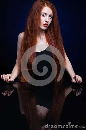 Free Young Woman With Ginger Hair Over Reflection Mirror On Blue Back Stock Photos - 78197243