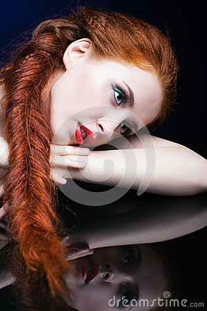 Free Young Woman With Ginger Hair Over Reflection Mirror On Blue Back Royalty Free Stock Images - 78197569