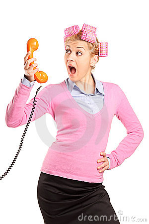 Free Young Woman With Hair Rollers Yelling On A Phone Royalty Free Stock Photography - 19199807