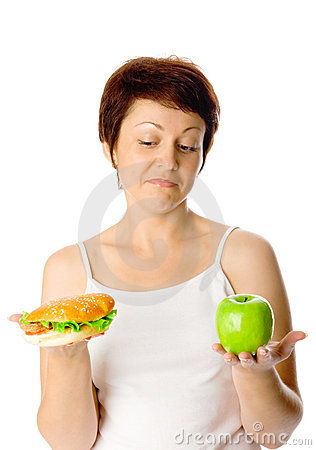 Free Young Woman With Hamburger And Apple Royalty Free Stock Photography - 10973947
