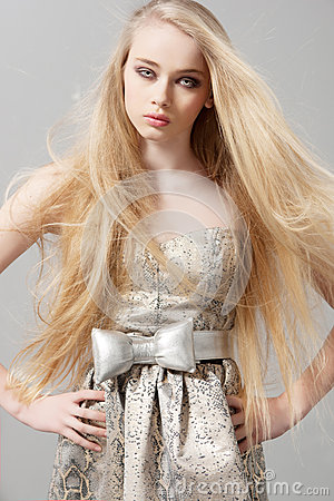 Free Young Woman With Long Blonde Hair In Fashion Dress Royalty Free Stock Image - 64987766