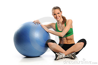 Young Woman workin gout with Swiss Ball