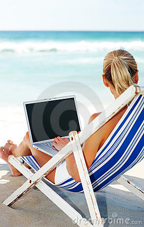 Young Woman Working On A Laptop Royalty Free Stock Image - Image: 8700866