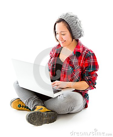Young woman working on a laptop with smiling
