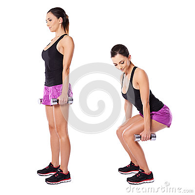 Young woman working out with barbells