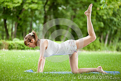 Young woman working out in nature